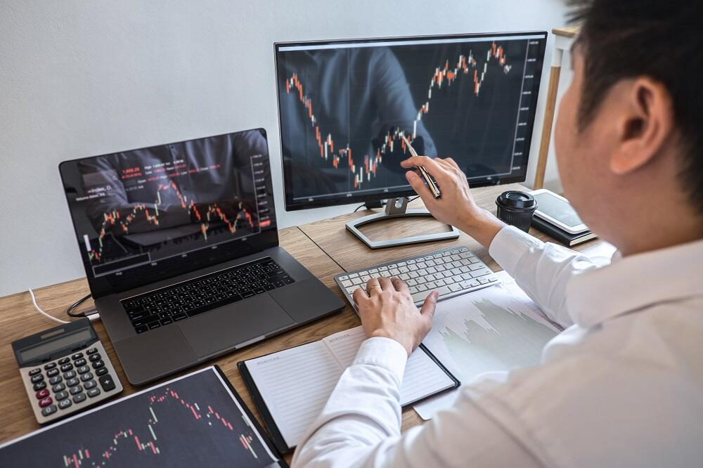 Business investor trading with Bitcoin Rush cryptocurrency trading app and analyzing with display screen, pointing on the data presented and deal on a stock exchange.